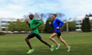 Mo Farah of Great Britain and Galen Rupp of the USA train on the grass at the Nike campus