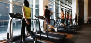 People on Treadmills --- Image by © Nice One Productions/Corbis
